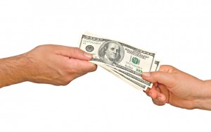 male and female hands pulling on US dollars